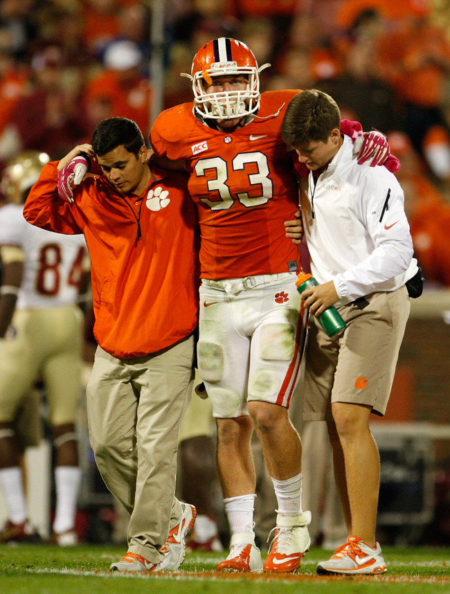 Hi-res-185376782-spencer-shuey-of-the-clemson-tigers-is-carried-off-the_crop_650