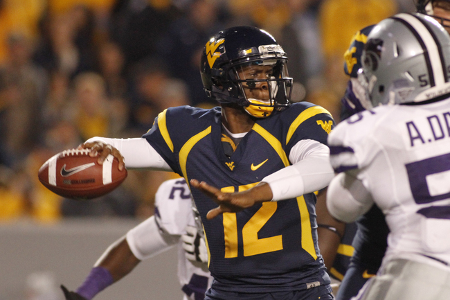 Hi-res-156656942-geno-smith-of-the-west-virginia-mountaineers-drops-back_crop_650