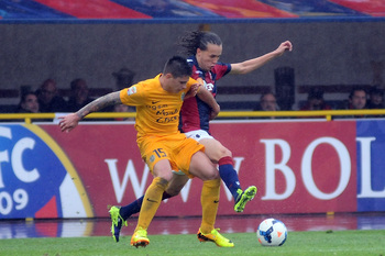 Hi-res-183689338-diego-laxalt-of-bologna-fc-competes-the-ball-with-juan_display_image