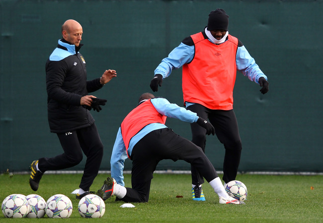 Hi-res-135066583-kolo-toure-of-manchester-city-tackles-mario-balotelli_crop_650