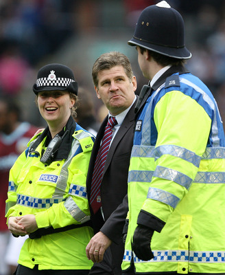 Hi-res-98937656-brian-laws-manager-of-burnley-is-escorted-by-two_display_image