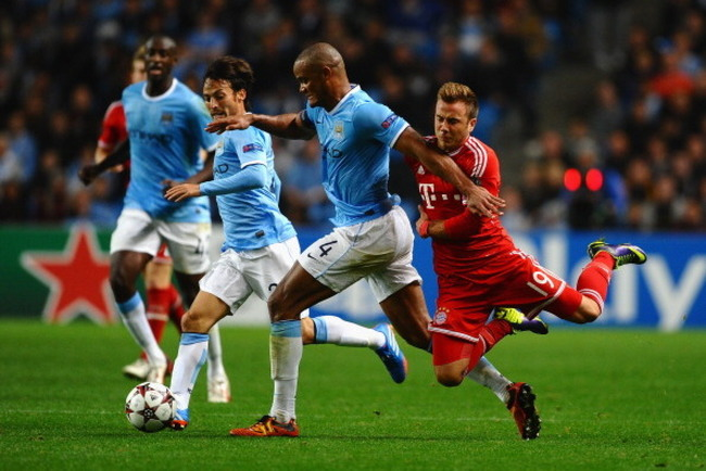 182937584-vincent-kompany-of-manchester-city-battles-with-mario_crop_650