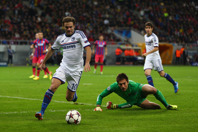 Hi-res-182600516-juan-mata-of-chelsea-rounds-ciprian-tatarusanu-the_crop_650