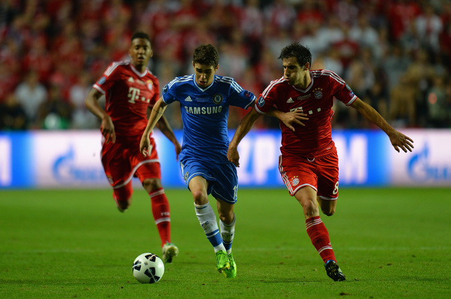Hi-res-178679096-oscar-of-chelsea-is-marshalled-by-javi-martinez-of_crop_650