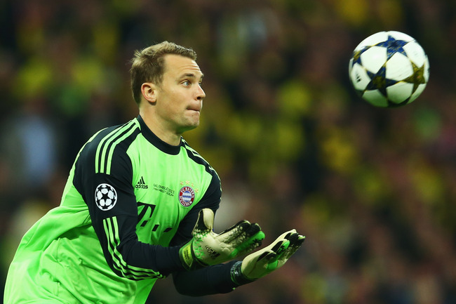 Hi-res-169511102-manuel-neuer-of-bayern-muenchen-catches-the-ball-during_crop_650