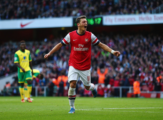 Hi-res-185350282-mesut-oezil-of-arsenal-celebrates-as-he-scores-their_crop_650