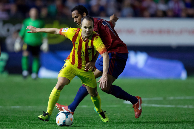 Hi-res-185359775-andres-iniesta-of-fc-barcelona-competes-for-the-ball_crop_650