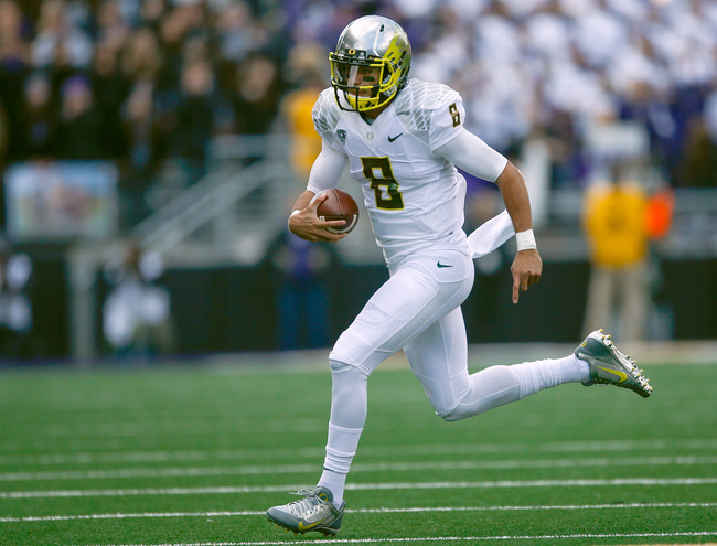 Hi-res-184791377-quarterback-marcus-mariota-of-the-oregon-ducks-rushes_crop_650
