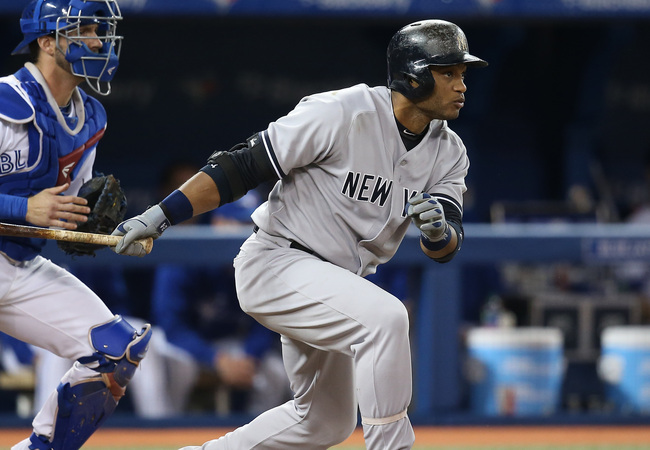 Hi-res-180980126-robinson-cano-of-the-new-york-yankees-hits-an-rbi_crop_650