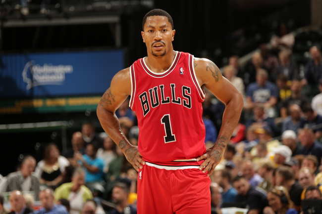 Hi-res-183192523-derrick-rose-of-the-chicago-bulls-looks-on-during-the_crop_650