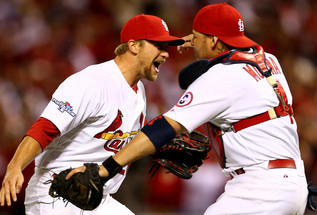Hi-res-185339365-trevor-rosenthal-and-catcher-yadier-molina-of-the-st_crop_650x440