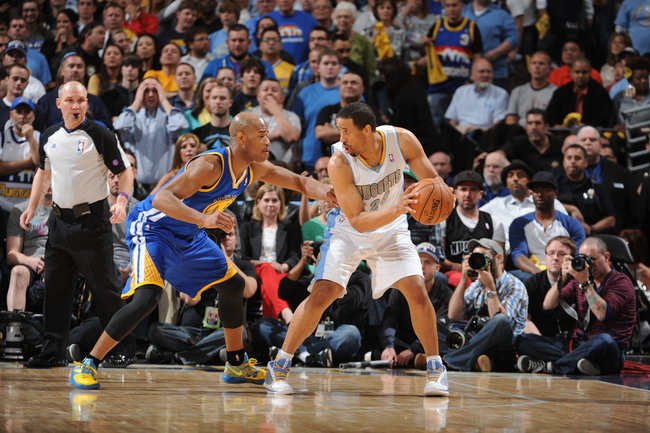 Hi-res-167842539-andre-miller-of-the-denver-nuggets-looks-to-pass-the_crop_650