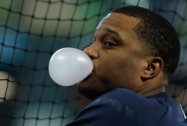 Hi-res-182044379-robinson-cano-of-the-new-york-yankees-waits-on-the_crop_650x440