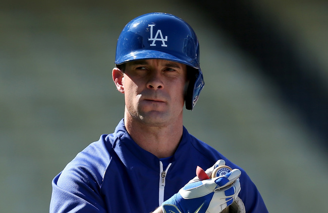 Hi-res-184708636-michael-young-of-the-los-angeles-dodgers-looks-on_crop_650