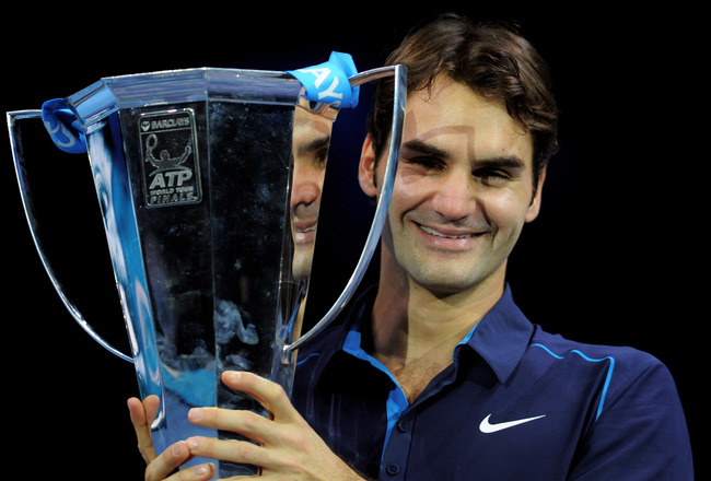 Hi-res-134167288-roger-federer-of-switzerland-holds-the-trophy-following_crop_650x440