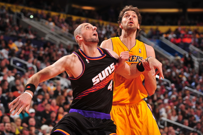 Hi-res-160408633-marcin-gortat-of-the-phoenix-suns-battles-for-position_crop_650