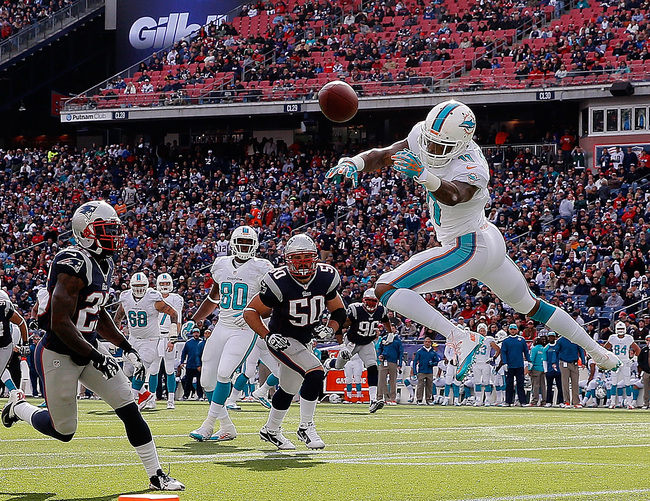 Hi-res-186042937-mike-wallace-of-the-miami-dolphins-drops-a-pass-near_crop_650