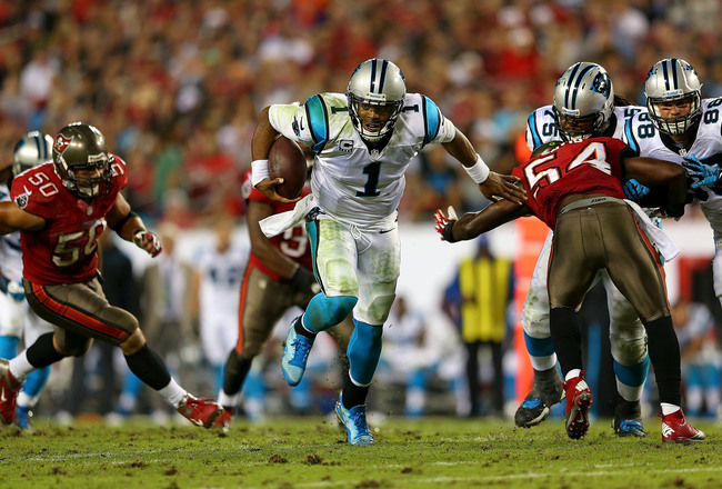 Hi-res-185776533-cam-newton-of-the-carolina-panthers-rushes-during-a_crop_650x440