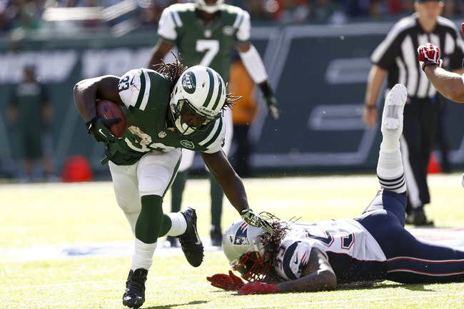 Hi-res-185422256-chris-ivory-of-the-new-york-jets-runs-from-brandon_crop_650