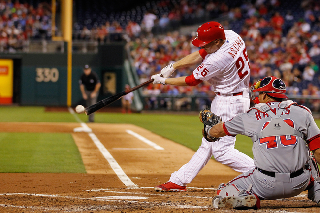 PHILADELPHIA, PA - SEPTEMBER 03: Cody Asche #25 of the Philadelphia Phillies gets a base hit in the second inning of the game against the Washington Nationals at Citizens Bank Park on September 3, 2013 in Philadelphia, Pennsylvania. (Photo by Brian Garfin