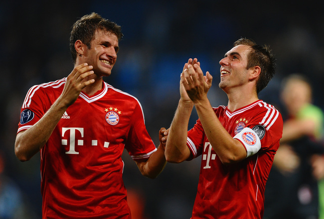 Hi-res-182937487-thomas-muller-and-philipp-lahm-of-fc-bayern-muenchen_crop_650x440