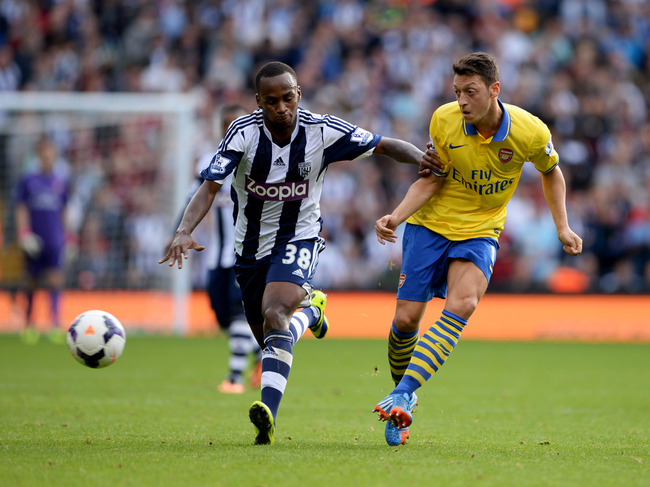 Hi-res-183436291-mesut-oezil-of-arsenal-battles-with-saido-berahino-of_crop_650