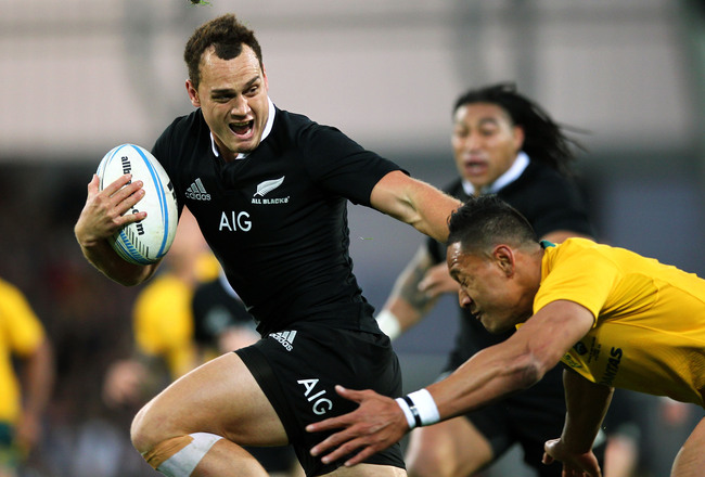 Hi-res-185342341-israel-dagg-of-new-zealand-beats-the-tackle-from-israel_crop_650x440