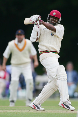 Hi-res-51055174-brian-lara-of-the-west-indies-hits-a-boundary-during-the_display_image