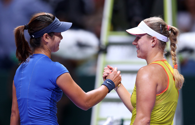 Hi-res-154744214-li-na-of-china-is-congratulated-by-angelique-kerber-of_crop_650