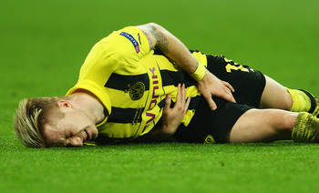 Hi-res-169508820-marco-reus-of-borussia-dortmund-is-injured-during-the_display_image