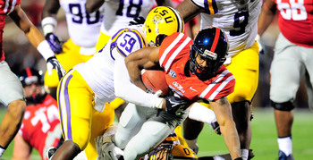 Hi-res-185379629-jermauria-rasco-of-the-lsu-tigers-tackles-jaylen-walton_display_image