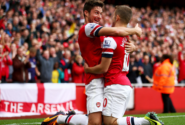 Hi-res-185347079-jack-wilshere-of-arsenal-celebrates-with-olivier-giroud_crop_650x440