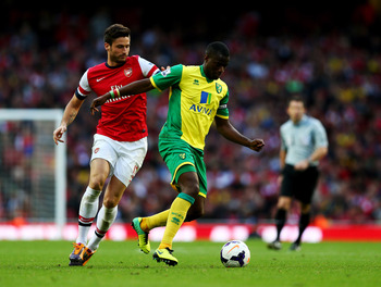 Hi-res-185347464-sebastien-bassong-of-norwich-city-holds-off-olivier_display_image
