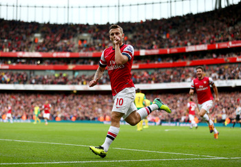 Hi-res-185347346-jack-wilshere-of-arsenal-celebrates-as-he-scores-their_display_image