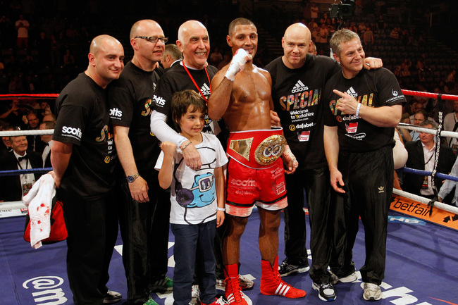 SHEFFIELD, ENGLAND - JULY 7:  Kell Brook (C) of England celebrates victory with his corner after his IBF Welterweight Title Eliminator Fight against Carson Jones of the USA at the Sheffield Motorpoint Arena on July 7, 2012 in Sheffield, England (Photo by