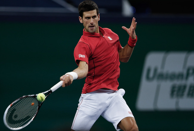 Hi-res-184389484-novak-djokovic-of-serbia-returns-a-shot-during-final_crop_650x440