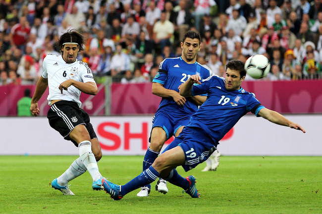 Hi-res-146691782-sokratis-papastathopoulos-of-greece-and-sami-khedira-of_crop_650