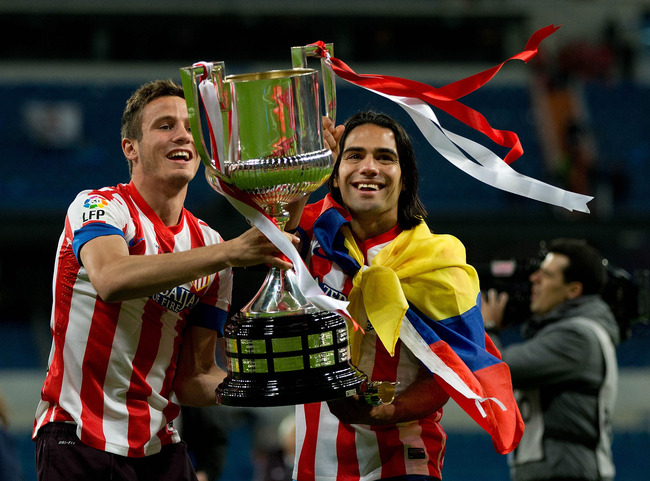 Hi-res-168964640-radamel-falcao-of-atletico-de-madrid-holds-the-trophy_crop_650