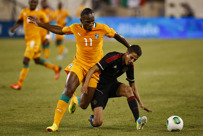 Hi-res-176526909-didier-drogba-of-ivory-coast-fights-for-the-ball-with_crop_650