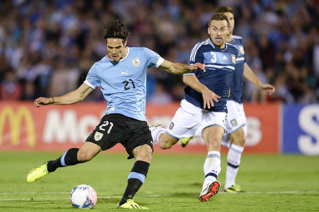 Hi-res-184746069-edinson-cavani-of-uruguay-vies-for-the-ball-with-hugo_crop_650