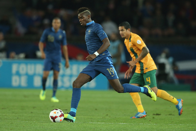Hi-res-184685010-paul-pogba-of-france-runs-with-the-ball-during-the_crop_650
