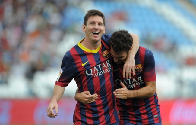 182582134-lionel-messi-celebrates-with-cesc-fabregas-after_crop_650