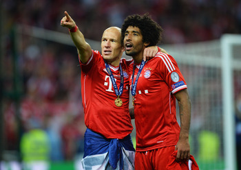 Hi-res-169504768-arjen-robben-of-bayern-muenchen-celebrates-victory-with_display_image