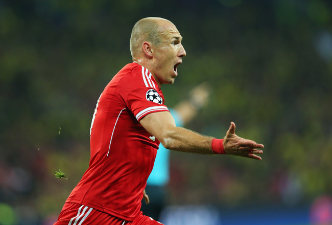 Hi-res-169502577-arjen-robben-of-bayern-muenchen-celebrates-as-he-scores_crop_650x440
