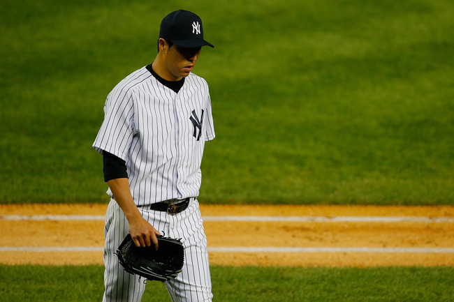 Hi-res-181763524-hiroki-kuroda-of-the-new-york-yankees-walks-off-the_crop_650
