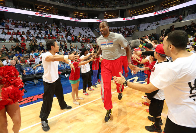 Hi-res-183935518-dwight-howard-of-the-houston-rockets-runs-onto-the_crop_650x440