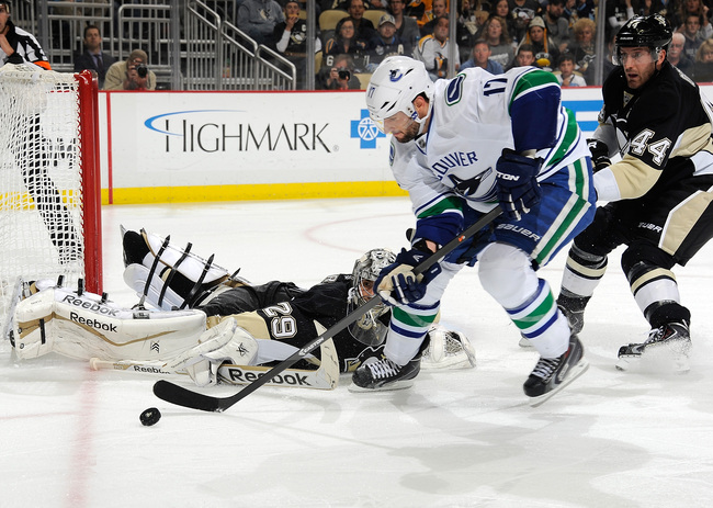 Hi-res-185352910-ryan-kesler-of-the-vancouver-canucks-moves-the-puck-in_crop_650