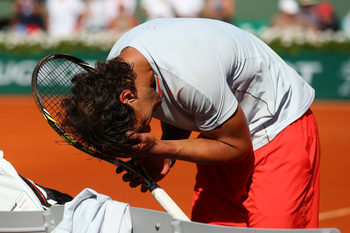 Hi-res-170116963-rafael-nadal-of-spain-celebrates-match-point-in-the_display_image