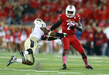 Hi-res-185339714-michaelee-harris-of-the-louisville-cardinals-is-tackled_display_image