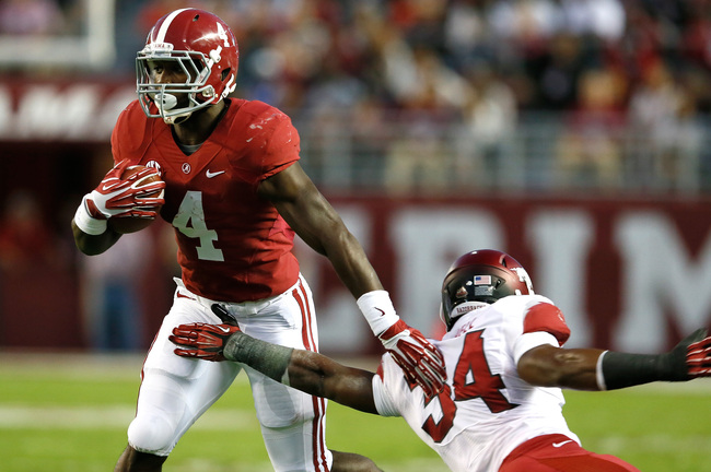 http://cdn.bleacherreport.net/images_root/slides/photos/003/400/108/hi-res-185373247-yeldon-of-the-alabama-crimson-tide-breaks-a-tackle-by_crop_650.jpg?1382237278
